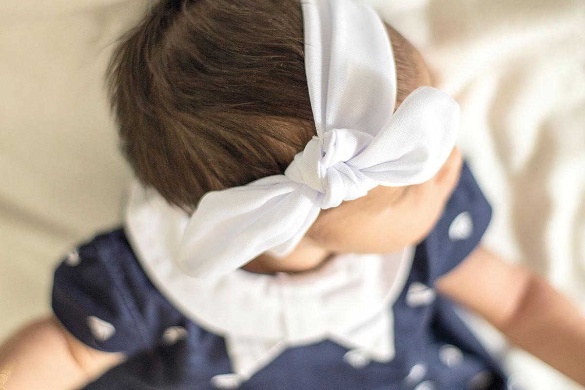 Fotografie. Babyfotos. Foto von der Haarschleife vom Baby.